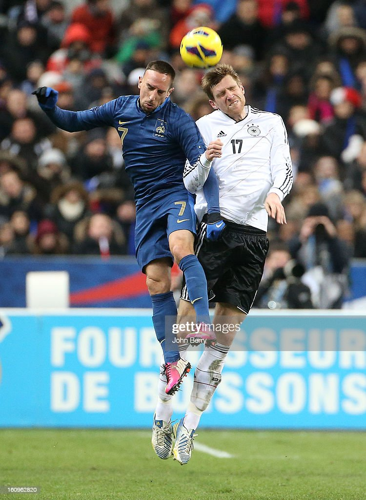 Franck Ribery of France and Per Mertesacker of Germany in action during the international friendly match between France and Germany at the Stade de France on February 6, 2013 in Paris, France.