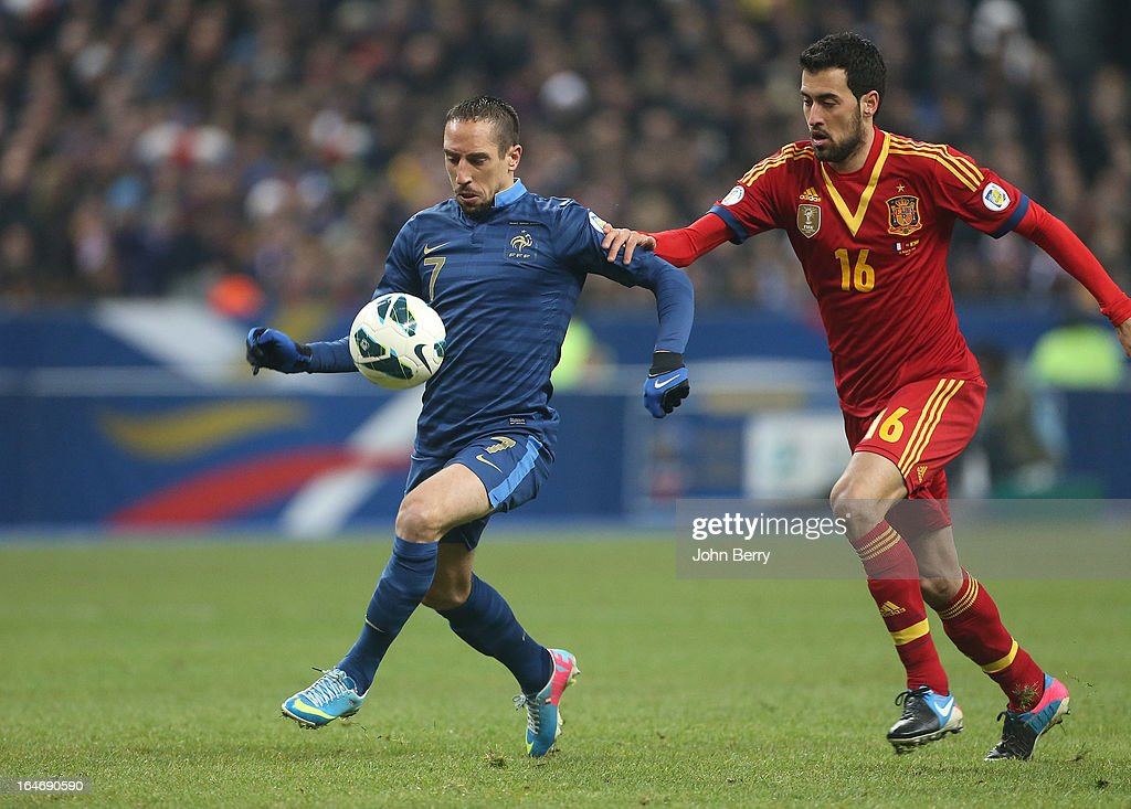 Franck Ribery of France and Sergio Busquets of Spain in action during the FIFA World Cup 2014 qualifier match between France and Spain at the Stade de France on March 26, 2013 in Saint-Denis near Paris, France.