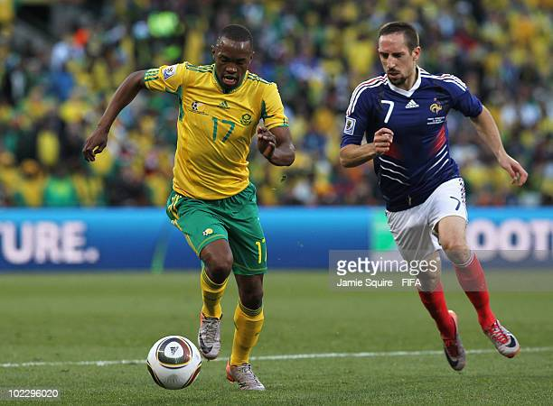 Franck Ribery of France challenges Bernard Parker of South Africa during the 2010 FIFA World Cup South Africa Group A match between France and South...