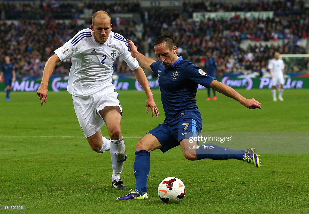 <a gi-track='captionPersonalityLinkClicked' href=/galleries/search?phrase=Franck+Ribery&family=editorial&specificpeople=490869 ng-click='$event.stopPropagation()'>Franck Ribery</a> of France crosses the ball ahead of <a gi-track='captionPersonalityLinkClicked' href=/galleries/search?phrase=Petri+Pasanen&family=editorial&specificpeople=234908 ng-click='$event.stopPropagation()'>Petri Pasanen</a> of Finland during the FIFA 2014 World Cup Qualifying Group I match between France and Finland at the Stade de France on October 15, 2013 in Paris, France.