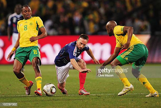 Franck Ribery of France in action under pressure from Siphiwe Tshabalala of South Africa during the 2010 FIFA World Cup South Africa Group A match...