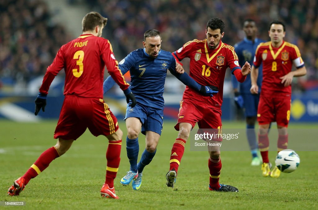 Franck Ribery of France is challenged by Sergio Busquets of Spain during a FIFA 2014 World Cup Qualifier between France and Spain at Stade de France on March 26, 2013 in Paris, France.