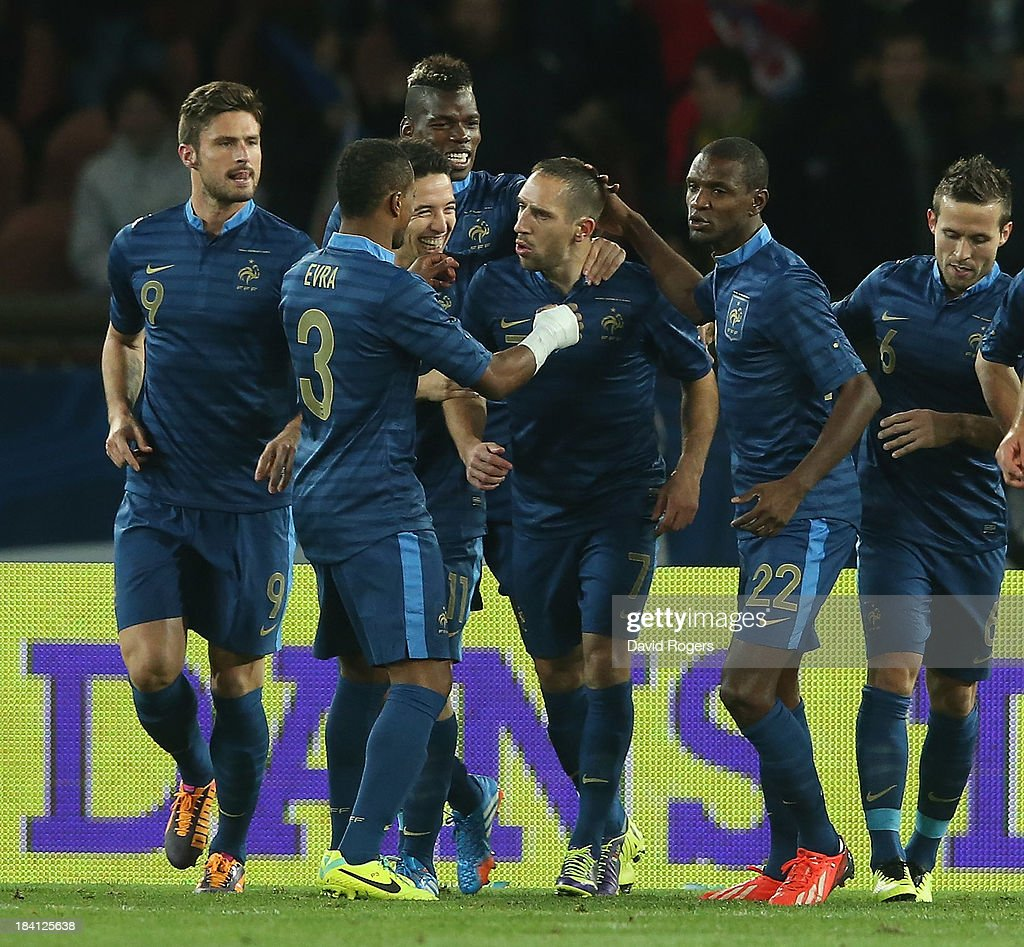 Franck Ribery of France is congratulated by team mates after scoring the first goal from a penalty during the International Friendly match between France and Australia at Parc des Princes on October 11, 2013 in Paris, France.