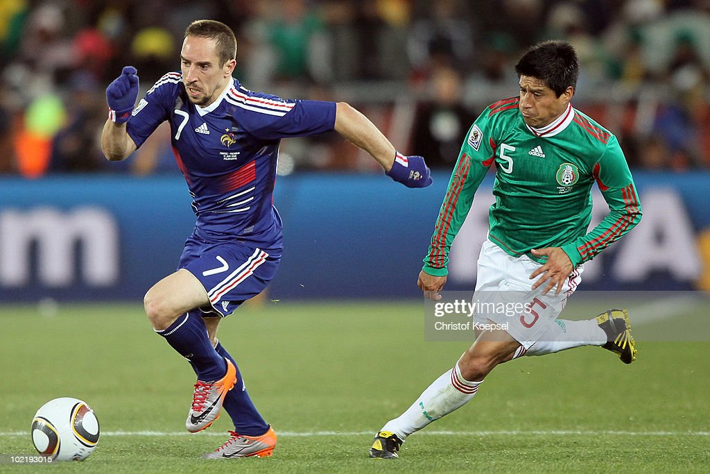 Franck Ribery (L) of France is followed by Ricardo Osorio of Mexico during the 2010 FIFA World Cup South Africa Group A match between France and Mexico at the Peter Mokaba Stadium on June 17, 2010 in Polokwane, South Africa.