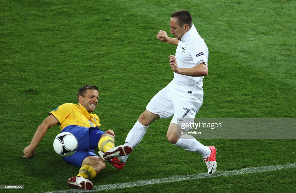 <a gi-track='captionPersonalityLinkClicked' href=/galleries/search?phrase=Franck+Ribery&family=editorial&specificpeople=490869 ng-click='$event.stopPropagation()'>Franck Ribery</a> of France is tackled by <a gi-track='captionPersonalityLinkClicked' href=/galleries/search?phrase=Anders+Svensson&family=editorial&specificpeople=167083 ng-click='$event.stopPropagation()'>Anders Svensson</a> of Sweden during the UEFA EURO 2012 group D match between Sweden and France at The Olympic Stadium on June 19, 2012 in Kiev, Ukraine.