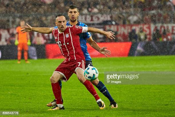 Franck Ribery of Muenchen and Aleksandar Dragovic battle for the ball during the Bundesliga match between FC Bayern Muenchen and Bayer 04 Leverkusen...