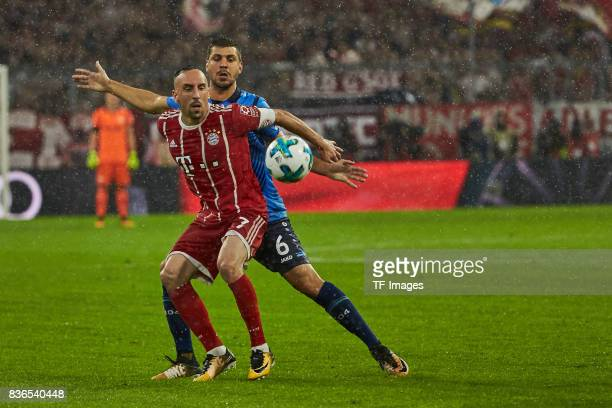 Franck Ribery of Muenchen and Aleksandar Dragovic of Leverkusen battle for the ball during the Bundesliga match between FC Bayern Muenchen and Bayer...