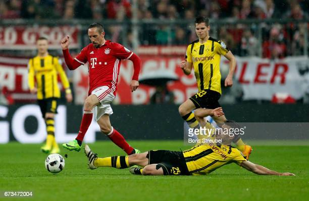 Franck Ribery of Muenchen and Sokratis of Dortmund battle for the ball during the DFB Cup semi final match between FC Bayern Muenchen and Borussia...