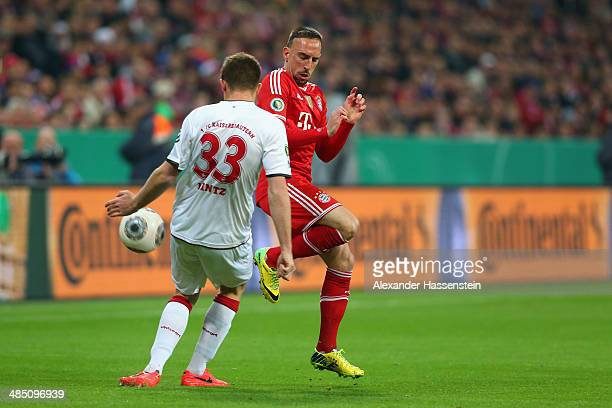 Franck Ribery of Muenchen battles for the ball with Dominique Heintz of Kaiserslautern during the DFB Cup semi final match between FC Bayern Muenchen...