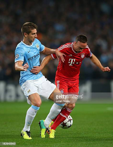 Franck Ribery of Muenchen battles with Matija Nastasic of Manchester City during the UEFA Champions League Group D match between Manchester City and...