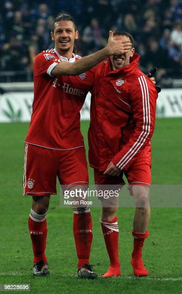 Franck Ribery of Muenchen celebrate with team mate Martin Demichelis after the Bundesliga match between FC Schalke 04 and FC Bayern Muenchen at the...
