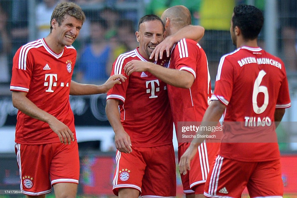Franck Ribery of Muenchen celebrates after scoring the opening goal with team mates during the Telekom Cup 2013 final match between Borussia Moenchengladbach and FC Bayern Muenchen at Borussia-Park on July 21, 2013 in Moenchengladbach, Germany.
