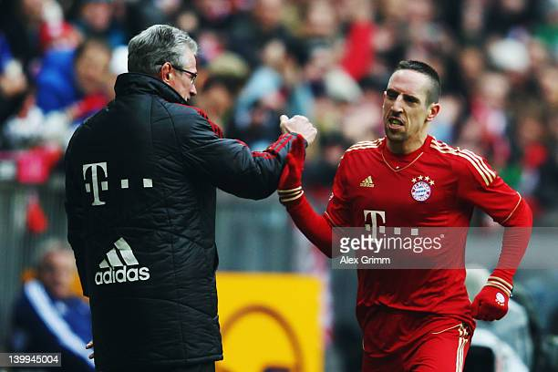 Franck Ribery of Muenchen celebrates his team's first goal with head coach Jupp Heynckes during the Bundesliga match between FC Bayern Muenchen and...