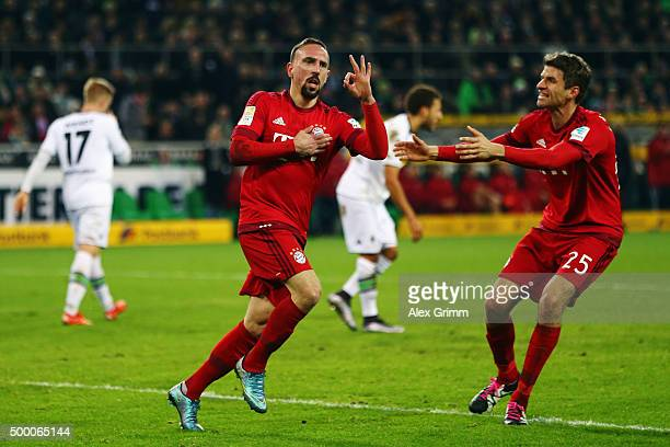 Franck Ribery of Muenchen celebrates his team's first goal with team mate Thomas Mueller during the Bundesliga match between Borussia...