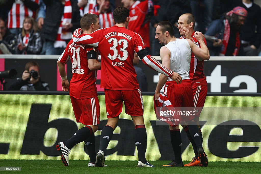Franck Ribery (2R) of Muenchen celebrates his team's fourth goal with team mates Arjen Robben (R), Mario Gomez (2L) and Bastian Schweinsteiger (L) during the Bundesliga match between FC Bayern Muenchen and Hamburger SV at Allianz Arena on March 12, 2011 in Munich, Germany.