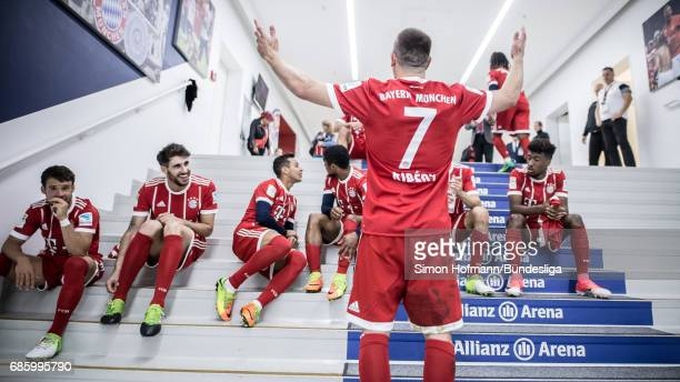 Franck Ribery of Muenchen celebrates in front of his team mates in the player's tunnel after the Bundesliga match between Bayern Muenchen and SC...