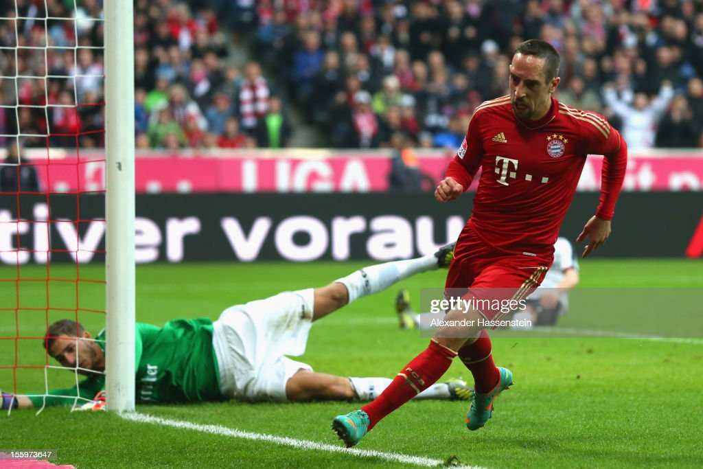 <a gi-track='captionPersonalityLinkClicked' href=/galleries/search?phrase=Franck+Ribery&family=editorial&specificpeople=490869 ng-click='$event.stopPropagation()'>Franck Ribery</a> of Muenchen celebrates scoring the opening goal against <a gi-track='captionPersonalityLinkClicked' href=/galleries/search?phrase=Kevin+Trapp&family=editorial&specificpeople=4409868 ng-click='$event.stopPropagation()'>Kevin Trapp</a> (L), keeper of Frankfurt during the Bundesliga match between FC Bayern Muenchen and Eintracht Frankfurt at Allianz Arena on November 10, 2012 in Munich, Germany.