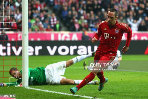 Franck Ribery of Muenchen celebrates scoring the opening goal against Kevin Trapp keeper of Frankfurt during the Bundesliga match between FC Bayern...