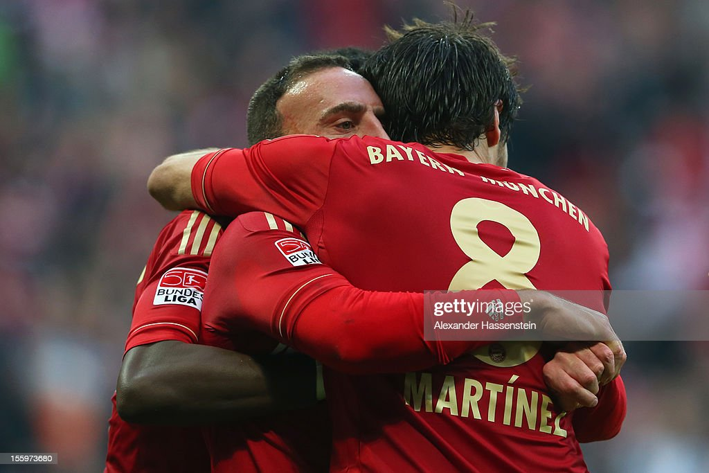 <a gi-track='captionPersonalityLinkClicked' href=/galleries/search?phrase=Franck+Ribery&family=editorial&specificpeople=490869 ng-click='$event.stopPropagation()'>Franck Ribery</a> of Muenchen celebrates scoring the opening goal with his team mates <a gi-track='captionPersonalityLinkClicked' href=/galleries/search?phrase=David+Alaba&family=editorial&specificpeople=5494608 ng-click='$event.stopPropagation()'>David Alaba</a> (L) and Javi Martinez during the Bundesliga match between FC Bayern Muenchen and Eintracht Frankfurt at Allianz Arena on November 10, 2012 in Munich, Germany.