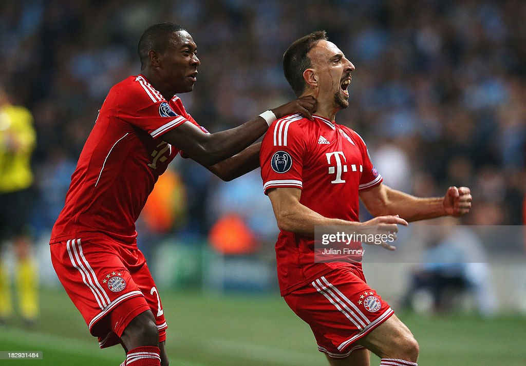 Franck Ribery of Muenchen celebrates scoring the opening goal with David Alaba of Muenchen during the UEFA Champions League Group D match between...
