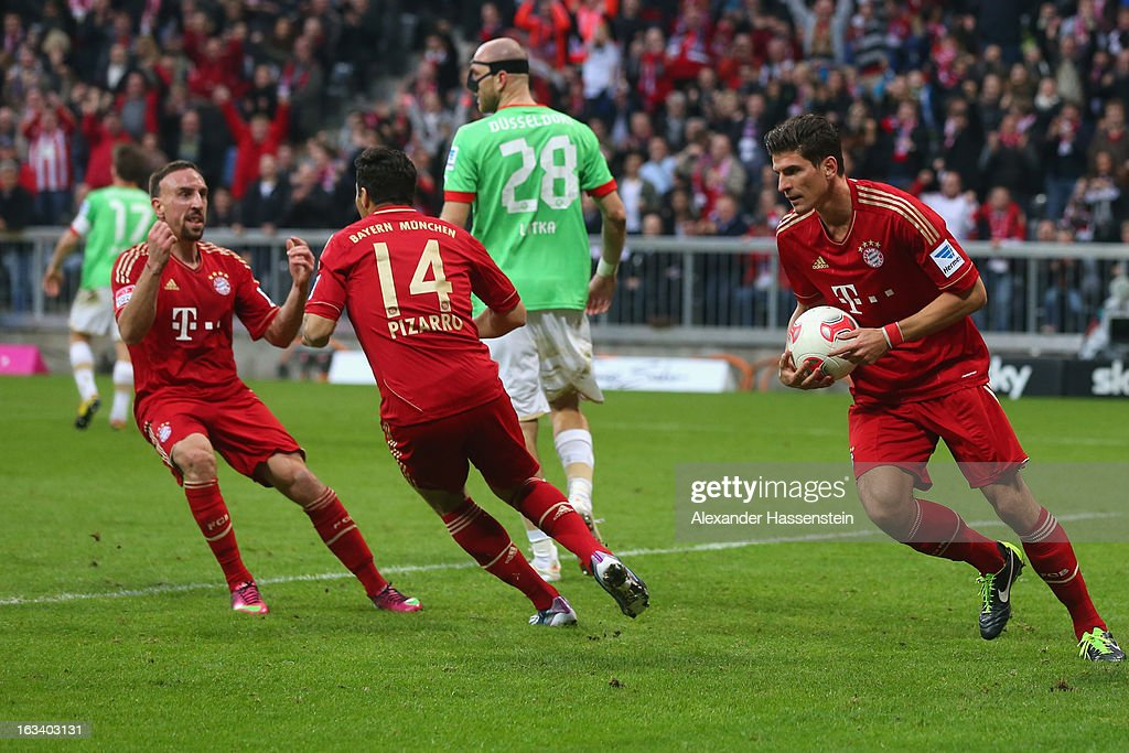 Franck Ribery (L) of Muenchen celebrates scoring the second team goal with his team mates Claudio Pizarro (C) and Mario Gomez (R) during the Bundesliga match between FC Bayern Muenchen and Fortuna Duesseldorf 1895 at Allianz Arena on March 9, 2013 in Munich, Germany.