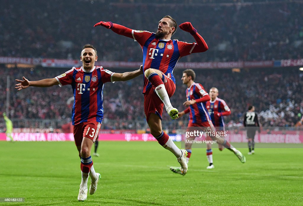 Franck Ribery of Muenchen celebrates with his teammates after scoring his team's first goal during the Bundesliga match between FC Bayern Muenchen...