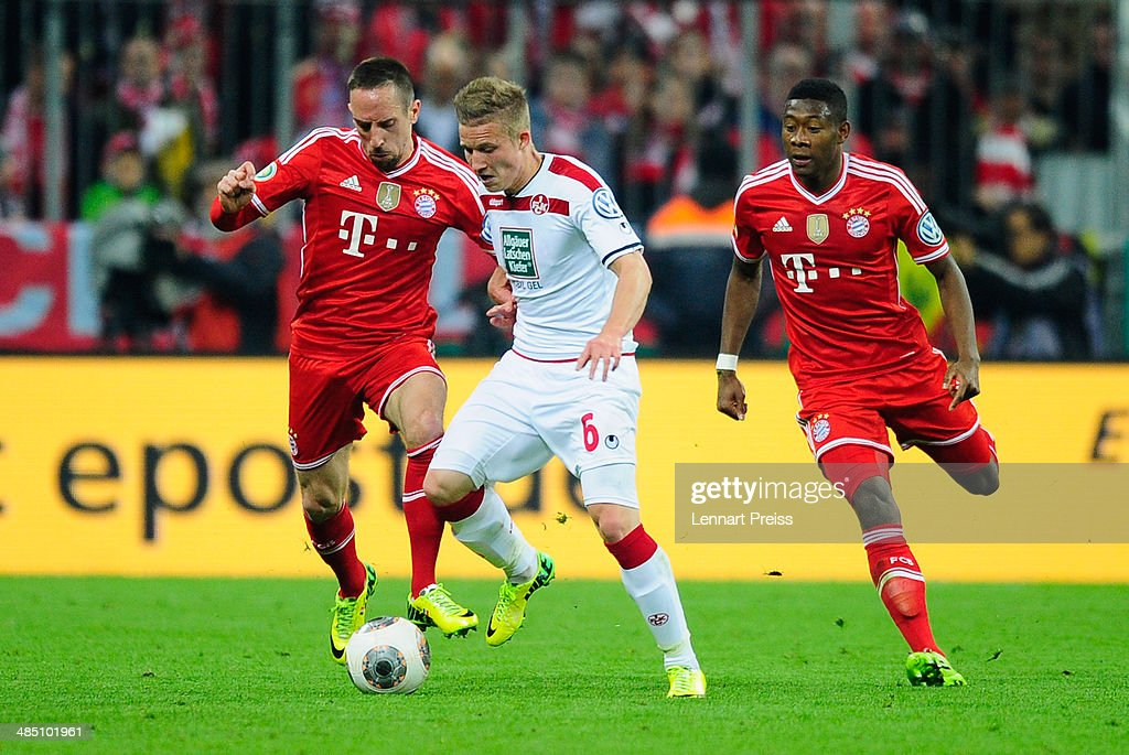 <a gi-track='captionPersonalityLinkClicked' href=/galleries/search?phrase=Franck+Ribery&family=editorial&specificpeople=490869 ng-click='$event.stopPropagation()'>Franck Ribery</a> (L) of Muenchen challenges <a gi-track='captionPersonalityLinkClicked' href=/galleries/search?phrase=Alexander+Ring&family=editorial&specificpeople=5588968 ng-click='$event.stopPropagation()'>Alexander Ring</a> (C) of Kaiserslautern during the DFB Cup semi final match between FC Bayern Muenchen and 1. FC Kaiserslautern at Allianz Arena on April 16, 2014 in Munich, Germany.