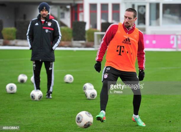 Franck Ribery of Muenchen in action next to head coach Josep Guardiola during a training session of FC Bayern Muenchen on January 27 2014 in Munich...