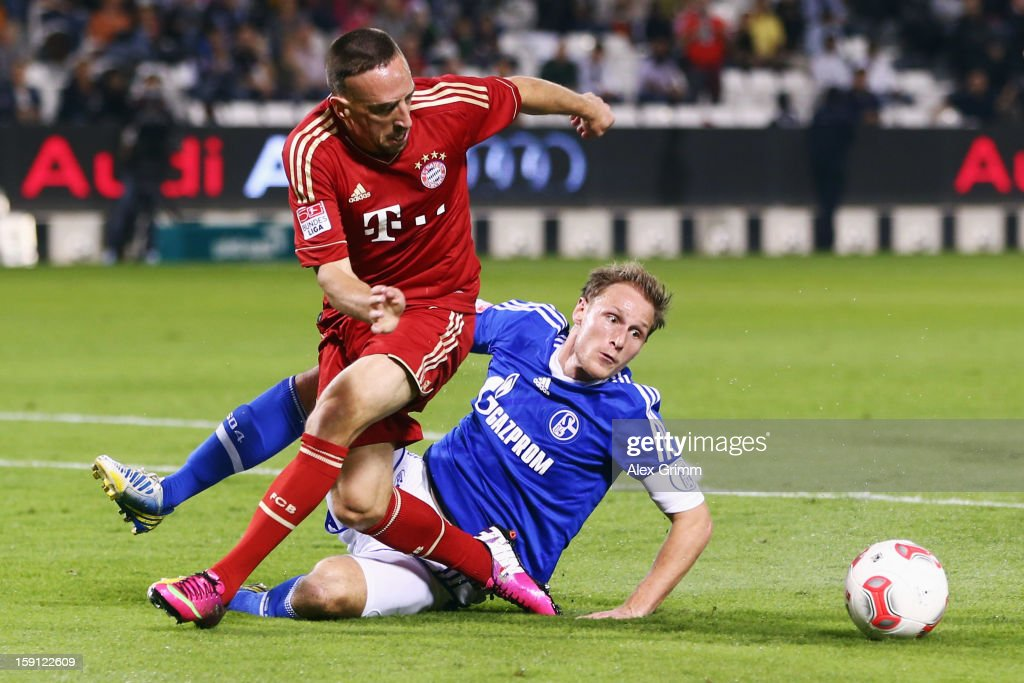 <a gi-track='captionPersonalityLinkClicked' href=/galleries/search?phrase=Franck+Ribery&family=editorial&specificpeople=490869 ng-click='$event.stopPropagation()'>Franck Ribery</a> (front) of Muenchen is challenged by <a gi-track='captionPersonalityLinkClicked' href=/galleries/search?phrase=Benedikt+Hoewedes&family=editorial&specificpeople=3945465 ng-click='$event.stopPropagation()'>Benedikt Hoewedes</a> of Schalke during the friendly match between Bayern Muenchen and FC Schalke 04 at Jassim Bin Hamad Stadium on January 8, 2013 in Doha, Qatar.