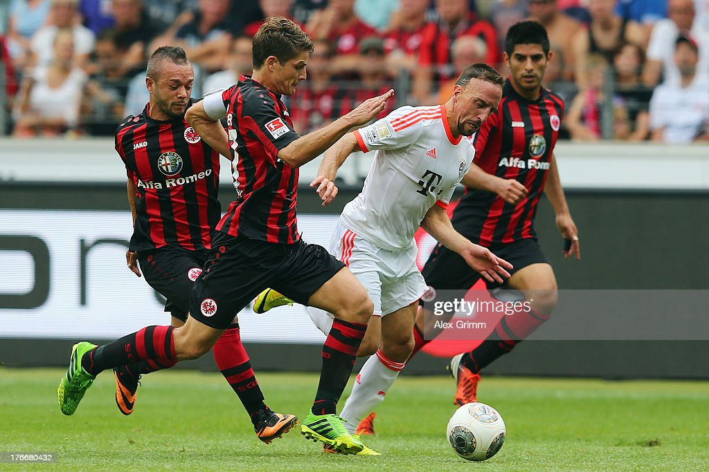<a gi-track='captionPersonalityLinkClicked' href=/galleries/search?phrase=Franck+Ribery&family=editorial&specificpeople=490869 ng-click='$event.stopPropagation()'>Franck Ribery</a> (2R) of Muenchen is challenged by <a gi-track='captionPersonalityLinkClicked' href=/galleries/search?phrase=Carlos+Zambrano&family=editorial&specificpeople=203225 ng-click='$event.stopPropagation()'>Carlos Zambrano</a>, <a gi-track='captionPersonalityLinkClicked' href=/galleries/search?phrase=Pirmin+Schwegler&family=editorial&specificpeople=604263 ng-click='$event.stopPropagation()'>Pirmin Schwegler</a> and <a gi-track='captionPersonalityLinkClicked' href=/galleries/search?phrase=Stephan+Schroeck&family=editorial&specificpeople=750505 ng-click='$event.stopPropagation()'>Stephan Schroeck</a> (R-L) of Frankfurt during the Bundesliga match between Eintracht Frankfurt and FC Bayern Muenchen at Commerzbank Arena on August 17, 2013 in Frankfurt am Main, Germany.