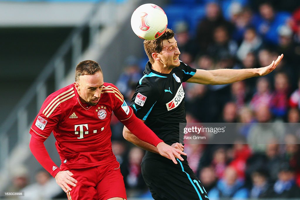 <a gi-track='captionPersonalityLinkClicked' href=/galleries/search?phrase=Franck+Ribery&family=editorial&specificpeople=490869 ng-click='$event.stopPropagation()'>Franck Ribery</a> (L) of Muenchen is challenged by David Abraham of Hoffenheim during the Bundesliga match between TSG 1899 Hoffenheim and FC Bayern Muenchen at Rhein-Neckar-Arena on March 3, 2013 in Sinsheim, Germany.