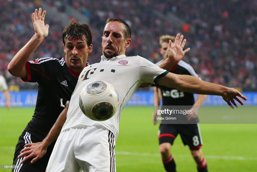 Franck Ribery (front) of Muenchen is challenged by Giulio Donati of Leverkusen during the Bundesliga match between Bayer Leverkusen and FC Bayern Muenchen at BayArena on October 5, 2013 in Leverkusen, Germany.