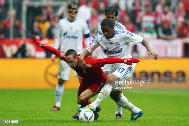 Franck Ribery of Muenchen is challenged by Jefferson Farfan of Schalke during the Bundesliga match between FC Bayern Muenchen and FC Schalke 04 at...