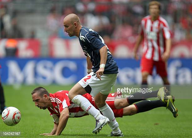Franck Ribery of Muenchen is challenged by Miso Brecko of Koeln during the Bundesliga match between FC Bayern Muenchen and 1 FC Koeln at Allianz...