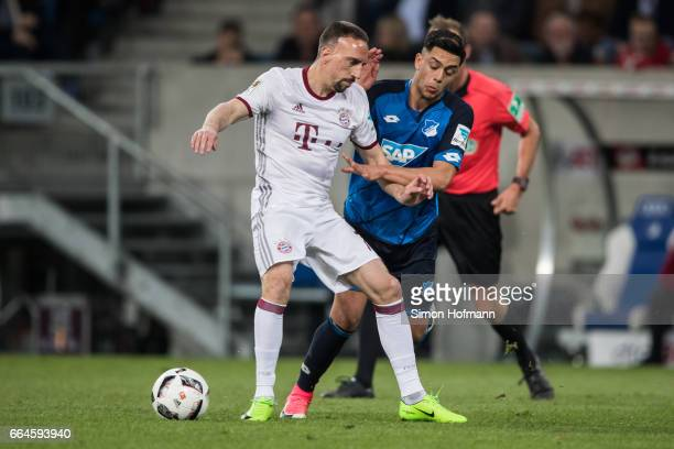 Franck Ribery of Muenchen is challenged by Nadiem Amiri of Hoffenheim during the Bundesliga match between TSG 1899 Hoffenheim and Bayern Muenchen at...