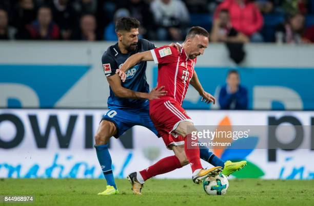 Franck Ribery of Muenchen is challenged by Nadiem Amiri of Hoffenheim during the Bundesliga match between TSG 1899 Hoffenheim and FC Bayern Muenchen...