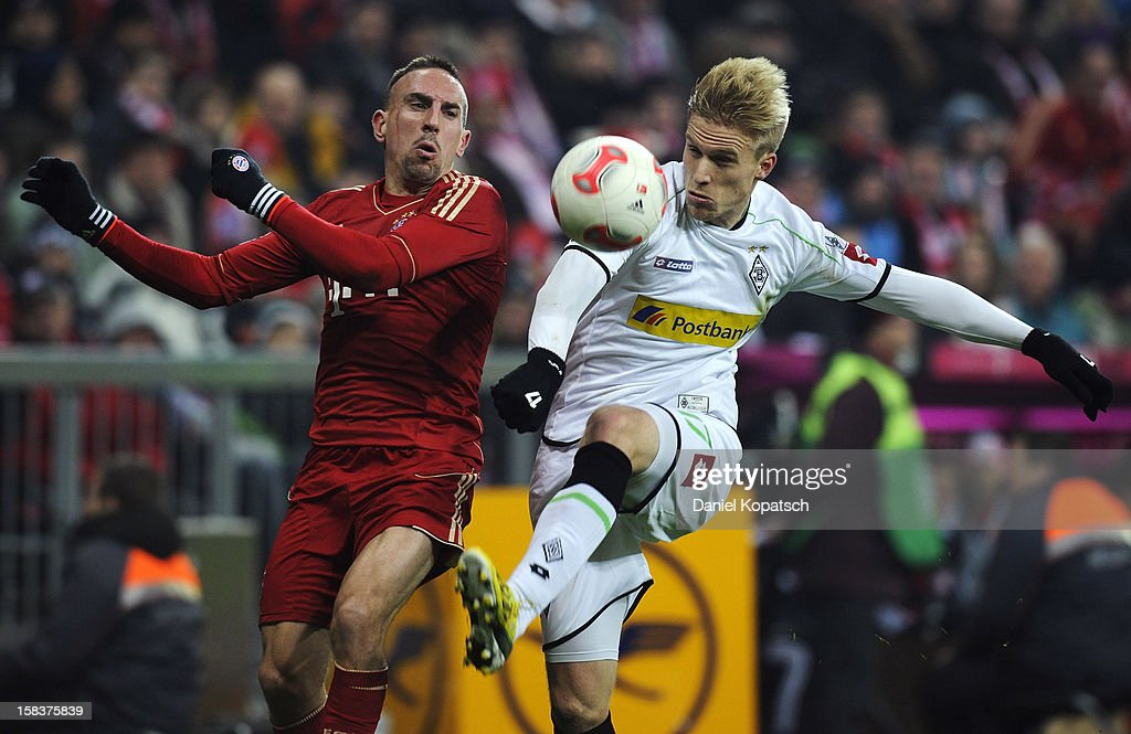 <a gi-track='captionPersonalityLinkClicked' href=/galleries/search?phrase=Franck+Ribery&family=editorial&specificpeople=490869 ng-click='$event.stopPropagation()'>Franck Ribery</a> of Muenchen (L) is challenged by Oscar Wendt of Moenchengladbach during the Bundesliga match between FC Bayern Muenchen and VfL Borussia Moenchengladbach at Allianz Arena on December 14, 2012 in Munich, Germany.
