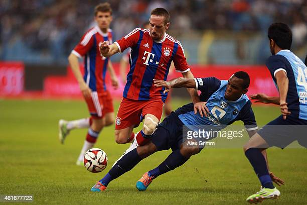 Franck Ribery of Muenchen is challenged by Silva Rodrigo Junior Paula of AlHilal during the friendly match between Al Hilal and Bayern Muenchen on...