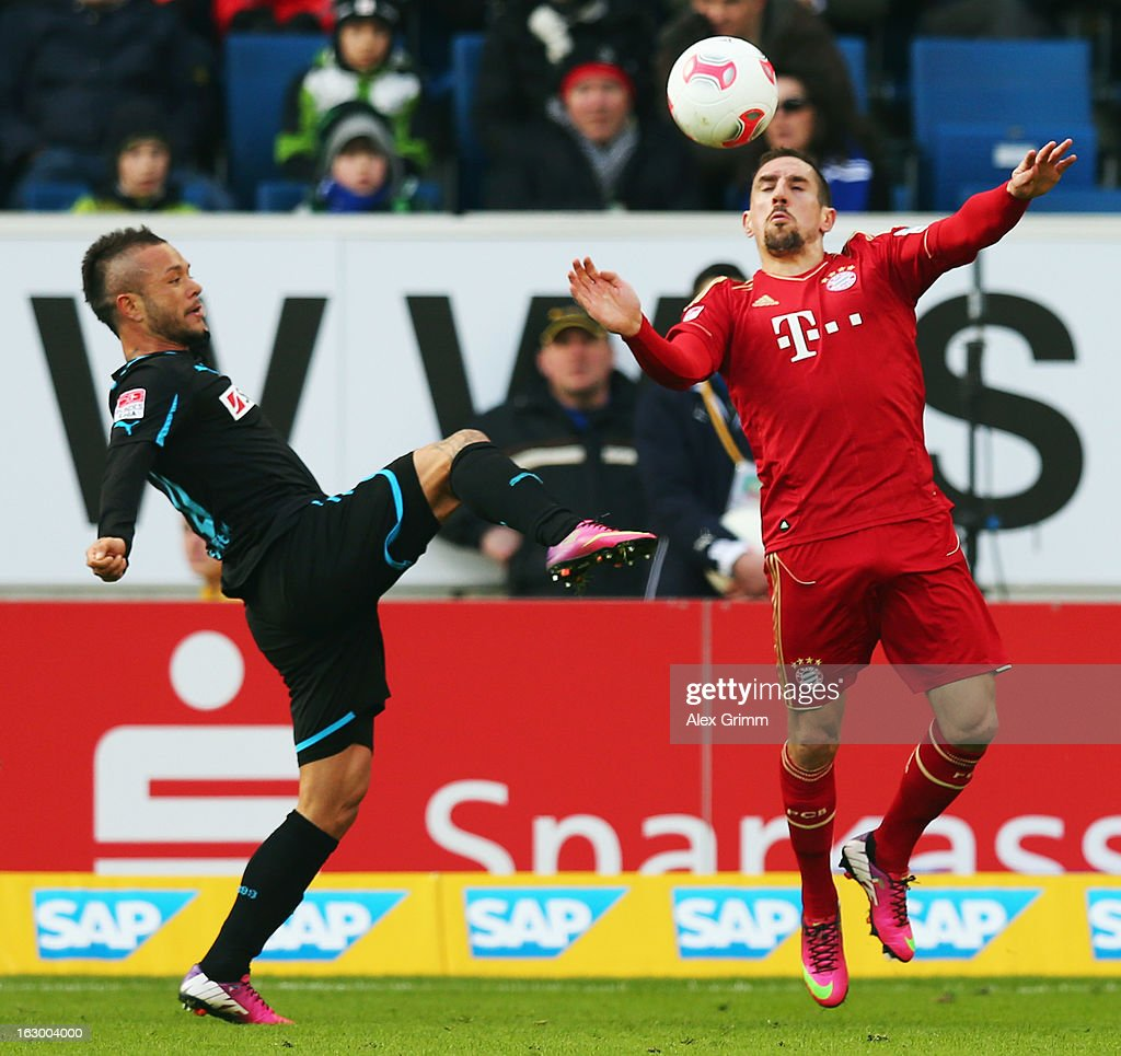 <a gi-track='captionPersonalityLinkClicked' href=/galleries/search?phrase=Franck+Ribery&family=editorial&specificpeople=490869 ng-click='$event.stopPropagation()'>Franck Ribery</a> (R) of Muenchen is challenged by <a gi-track='captionPersonalityLinkClicked' href=/galleries/search?phrase=Stephan+Schroeck&family=editorial&specificpeople=750505 ng-click='$event.stopPropagation()'>Stephan Schroeck</a> of Hoffenheim during the Bundesliga match between TSG 1899 Hoffenheim and FC Bayern Muenchen at Rhein-Neckar-Arena on March 3, 2013 in Sinsheim, Germany.