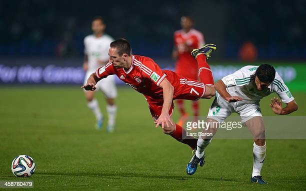 Franck Ribery of Muenchen is challenged by Zakaria El Hachimi of Casablanca during the FIFA Club World Cup Final between FC Bayern Muenchen and Raja...