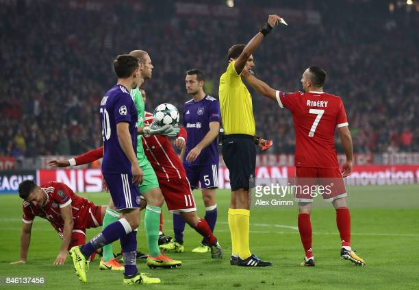 Franck Ribery of Muenchen is shown an yellow card by referee Paolo Tagliavento during the UEFA Champions League group B match between Bayern Muenchen...