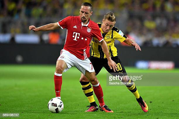 Franck Ribery of Muenchen is tackled by Felix Passlack of Dortmund during the DFL Supercup 2016 match between Borussia Dortmund and FC Bayern...