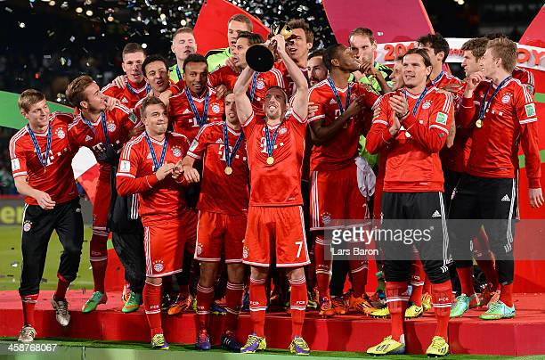 Franck Ribery of Muenchen lifts the trophy after winning the FIFA Club World Cup Final between FC Bayern Muenchen and Raja Casablanca at Marrakech...