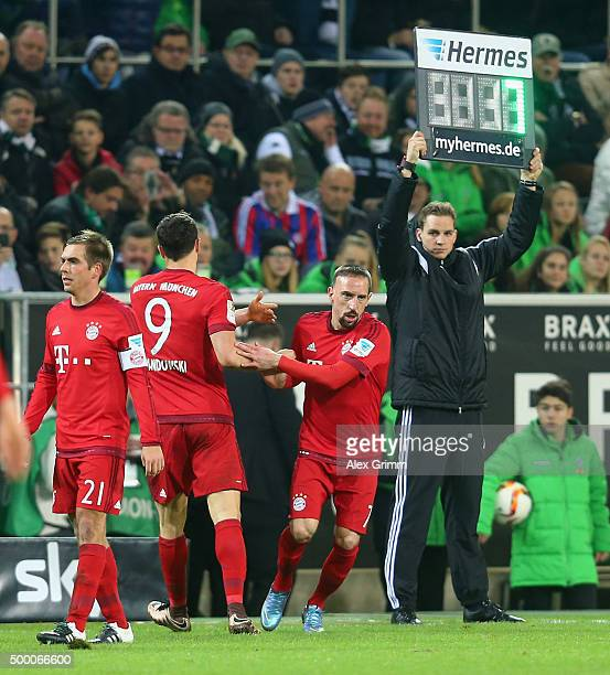 Franck Ribery of Muenchen replaces team mate Robert Lewandowski during the Bundesliga match between Borussia Moenchengladbach and FC Bayern Muenchen...