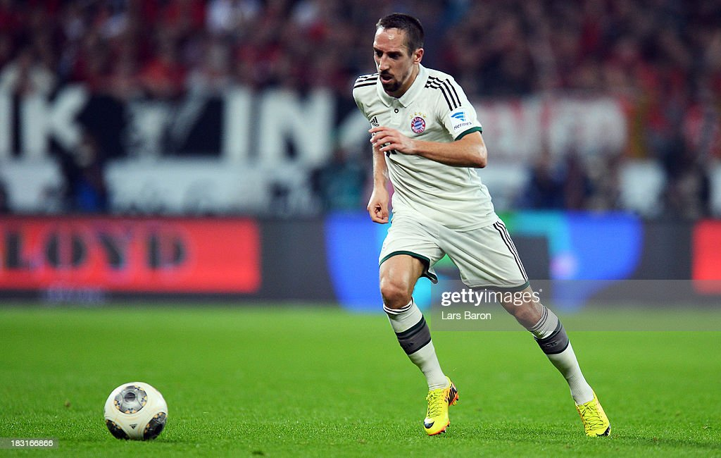 Franck Ribery of Muenchen runs with the ball during the Bundesliga match between Bayer Leverkusen and FC Bayern Muenchen at BayArena on October 5, 2013 in Leverkusen, Germany.