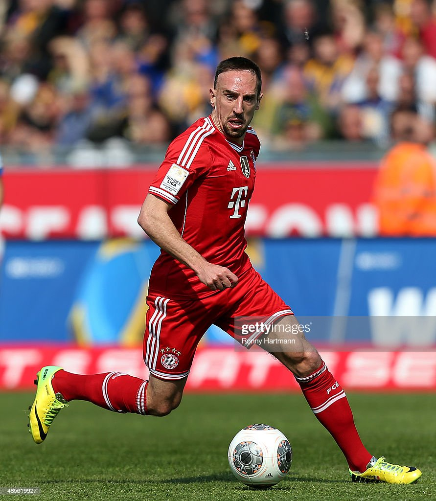 <a gi-track='captionPersonalityLinkClicked' href=/galleries/search?phrase=Franck+Ribery&family=editorial&specificpeople=490869 ng-click='$event.stopPropagation()'>Franck Ribery</a> of Muenchen runs with the ball during the Bundesliga match between Eintracht Braunschweig and FC Bayern Muenchen at Eintracht Stadion on April 19, 2014 in Braunschweig, Germany.