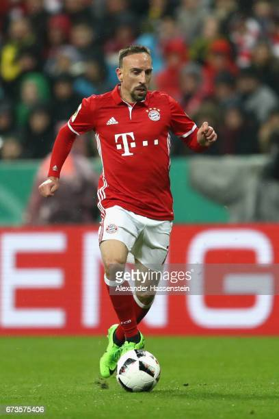 Franck Ribery of Muenchen runs with the ball during the DFB Cup semi final match between FC Bayern Muenchen and Borussia Dortmund at Allianz Arena on...