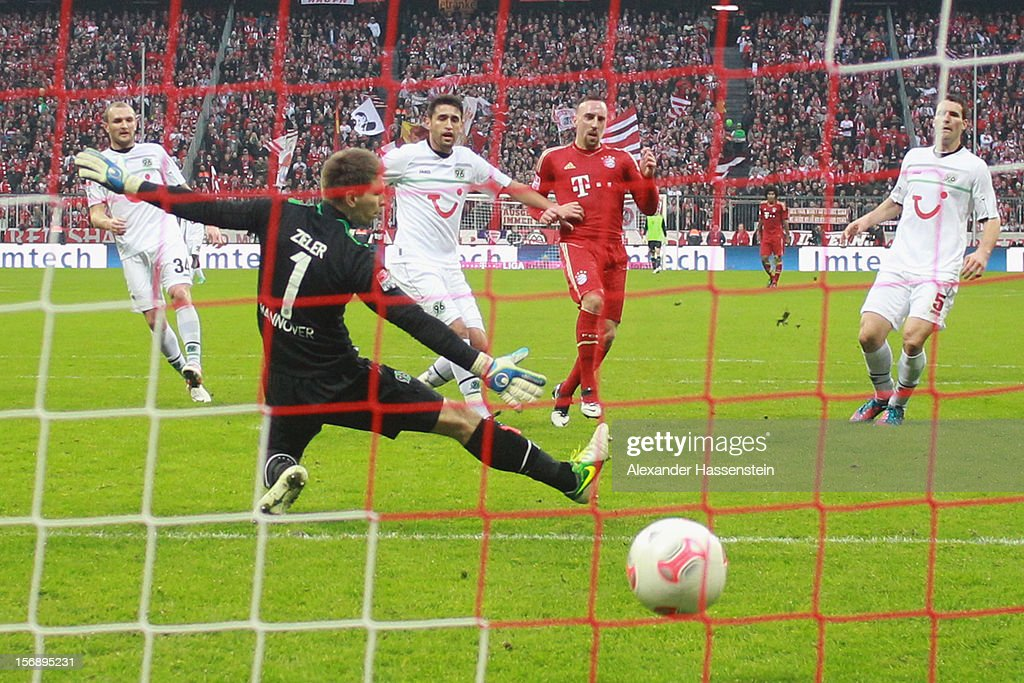 <a gi-track='captionPersonalityLinkClicked' href=/galleries/search?phrase=Franck+Ribery&family=editorial&specificpeople=490869 ng-click='$event.stopPropagation()'>Franck Ribery</a> (C) of Muenchen scores the 3rd team goal against Robert Ziegler, keeper of Hannover during the Bundesliga match between FC Bayern Muenchen and Hannover 96 at Allianz Arena on November 24, 2012 in Munich, Germany.