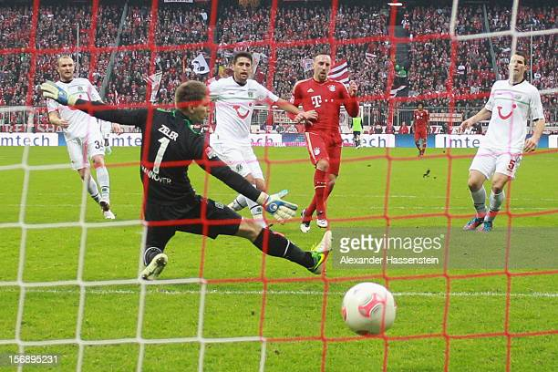 Franck Ribery of Muenchen scores the 3rd team goal against Robert Ziegler keeper of Hannover during the Bundesliga match between FC Bayern Muenchen...