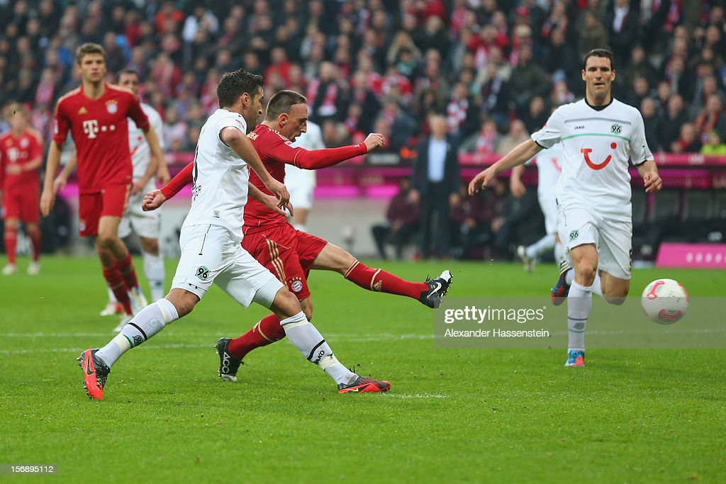 Franck Ribery of Muenchen scores the 3rd team goal aginst Karim Haggui of Hannover during the Bundesliga match between FC Bayern Muenchen and...